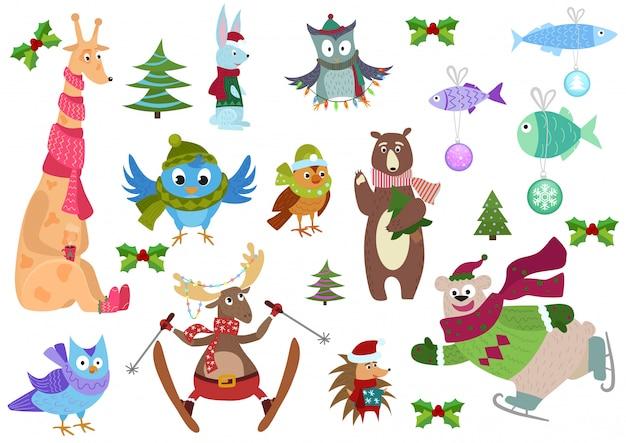 Conjunto de animais de inverno adorável natal e peixe com decorações coloridas.