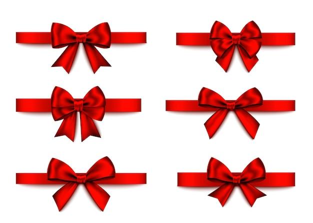 Conjunto de arcos de presente vermelho isolado no fundo branco. natal, ano novo, decoração de aniversário. elemento de decoração realista de vetor para banner, cartão, cartaz.