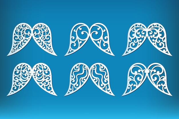 Conjunto de asas de anjo de natal isoladas em azul