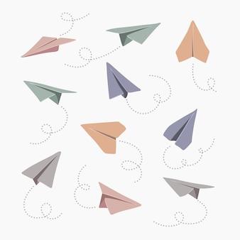 Conjunto de aviões de papel desenhado à mão. símbolo de viagem e rota.