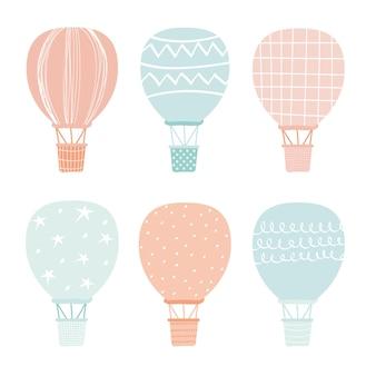Conjunto de balão de ar quente. transporte de bebê fofo. balão montgolfier em estilo escandinavo. design universal para adesivos, estampas de camisetas, designs de cartões postais. ilustração vetorial desenhada à mão