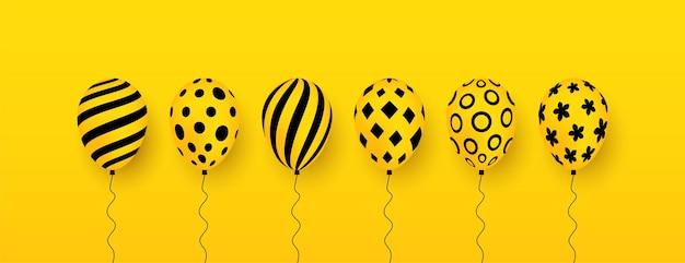Conjunto de balões com padrão em fundo amarelo balões para decorações de festas de aniversário