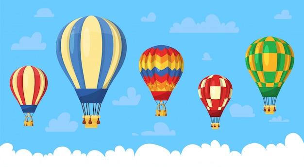 Conjunto de balões de ar quente no ar