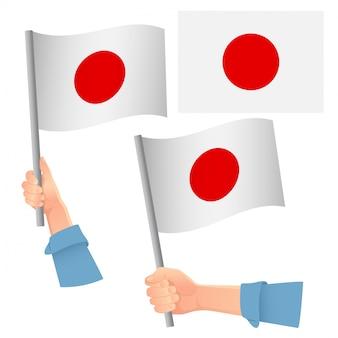 Conjunto de bandeira do japão na mão