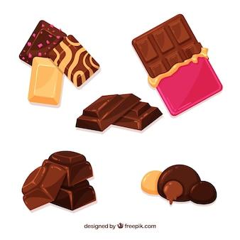 Conjunto de barras e pedaços de chocolate delicioso