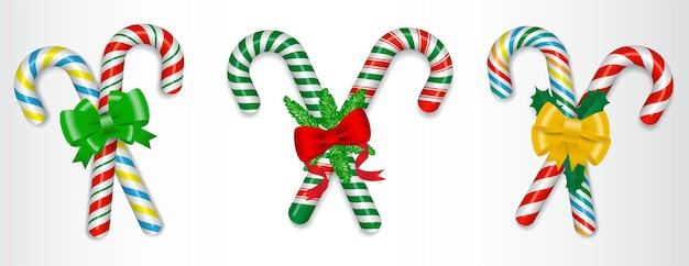 Conjunto de bastão de doces realista natal isolado ou cruzado doce doce amarrado com um laço ou doce
