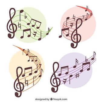 Conjunto de bastões e notas musicais