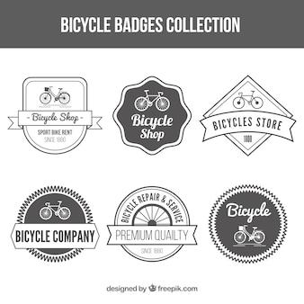 Conjunto de bicicleta do vintage da loja emblemas