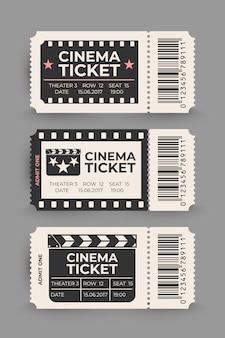 Conjunto de bilhetes de cinema isolado em fundo cinza.