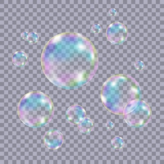 Conjunto de bolhas de sabão coloridas transparentes realistas com o reflexo do arco-íris isolado