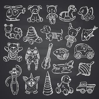 Conjunto de brinquedos infantis desenhados à mão e isolados no fundo do quadro negro.