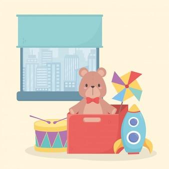 Conjunto de brinquedos para crianças perto da janela