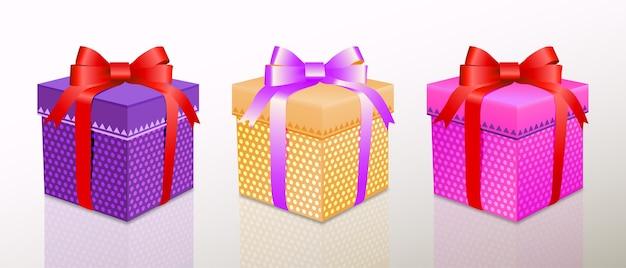 Conjunto de caixa de presente de natal ou aniversário com envoltório colorido e fitas