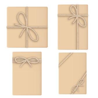 Conjunto de caixa de presente marrom amarrada com corda para seu projeto.
