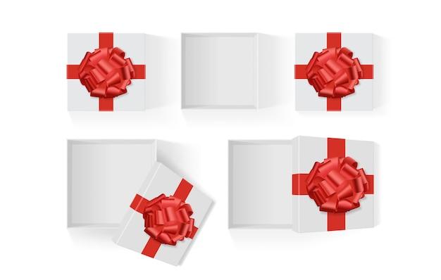 Conjunto de caixas brancas abertas com um grande laço vermelho de presente em um modelo de fundo branco