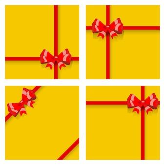 Conjunto de caixas de presente amarelas, amarradas com fitas vermelhas e laços, com sombras. vista do topo. design plano