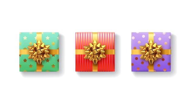 Conjunto de caixas de presente. caixa de presente com fitas e laço de ouro realistas brilhantes.