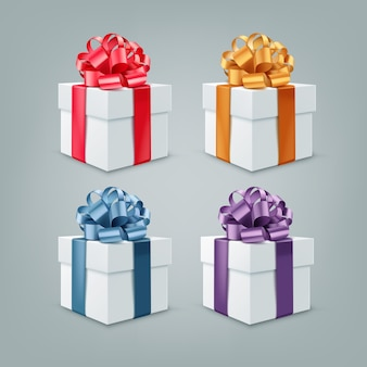 Conjunto de caixas de presente com fitas coloridas e arcos grandes