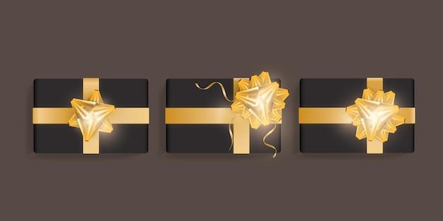 Conjunto de caixas de presente preta com laço de fita de ouro. modelo de caixa de presente realista bonito para aniversário, natal, design de ano novo. ilustração em vetor vista superior