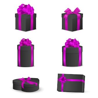 Conjunto de caixas de presente preta com laços e fitas cor de rosa.