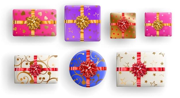 Conjunto de caixas de presente quadradas, retangulares e circulares coloridas com fitas, laços e vários padrões