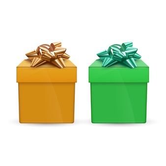 Conjunto de caixas de presente verde e laranja com laços