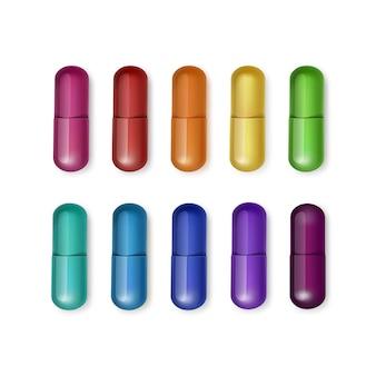 Conjunto de cápsulas multicoloridas, isolado no fundo branco
