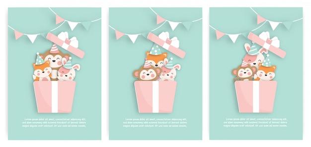 Conjunto de cartões de aniversário com animais fofos em uma caixa de presente. estilo de corte de papel.