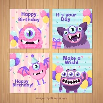 Conjunto de cartões de aniversário com monstros engraçados