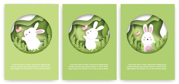Conjunto de cartões de chuveiro de bebê com coelhos bonitos na floresta. estilo de corte de papel.