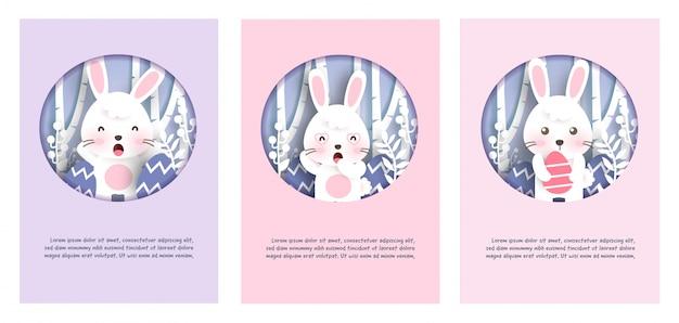 Conjunto de cartões de dia de páscoa com coelhinho fofo no estilo de corte e artesanato de papel. feliz páscoa .