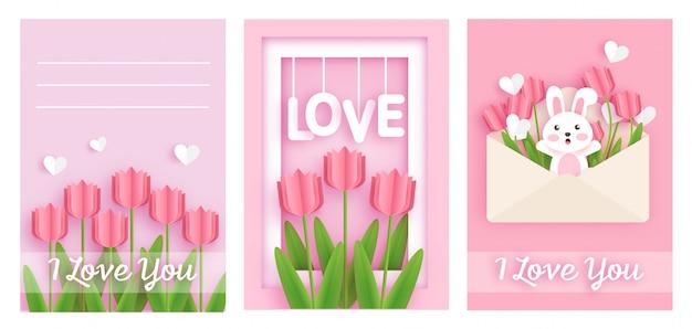 Conjunto de cartões de dia dos namorados com coelhos bonitos e tulipas.