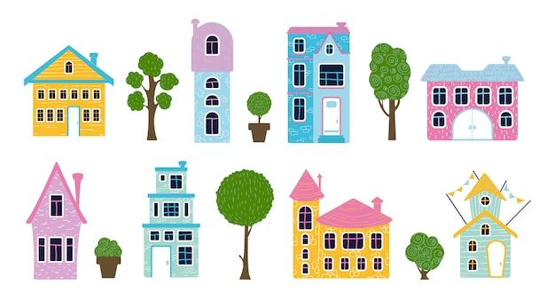Conjunto de casas de desenho bonito e árvores