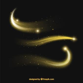 Conjunto de caudas de pó brilhante na cor dourada