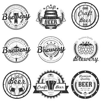Conjunto de cerveja artesanal vintage, logotipos de cervejaria, emblemas, distintivos, rótulos isolados