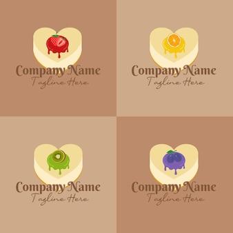Conjunto de cheesecake em forma de coração com várias frutas no topo do modelo de logotipo de geleia em fundo marrom