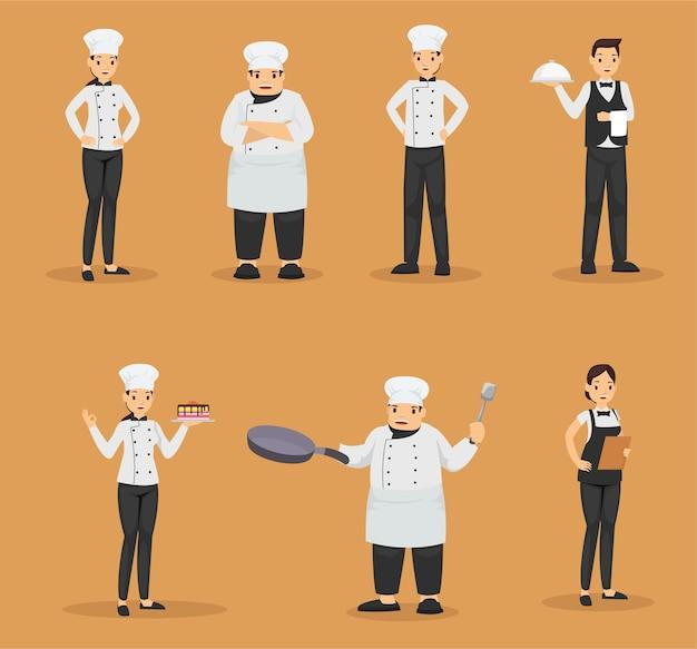 Conjunto de chef e garçons no restaurante