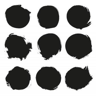 Conjunto de círculos pretos do grunge.