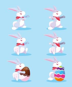 Conjunto de coelhinhos com ovos de páscoa, feliz páscoa