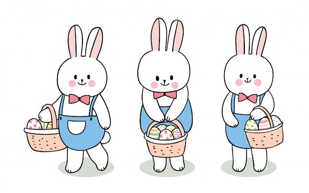 Conjunto de coelhos de dia de páscoa bonito dos desenhos animados e ovos coloridos no conjunto de cesta.