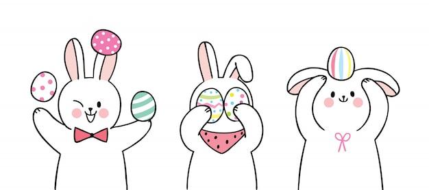 Conjunto de coelhos de dia de páscoa bonito dos desenhos animados e ovos coloridos.
