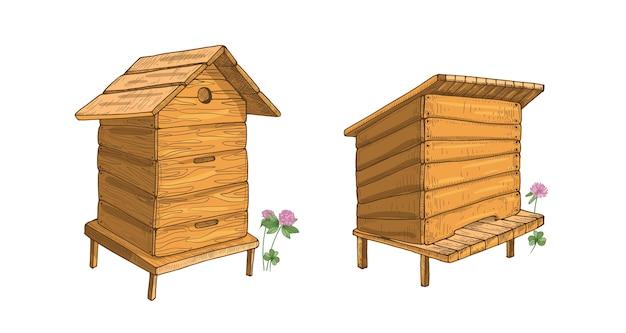 Conjunto de colmeias de madeira isoladas em branco