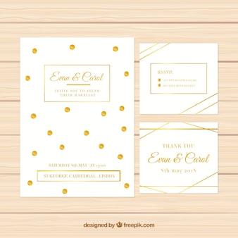 Conjunto de convites brancos de casamento com elementos dourados