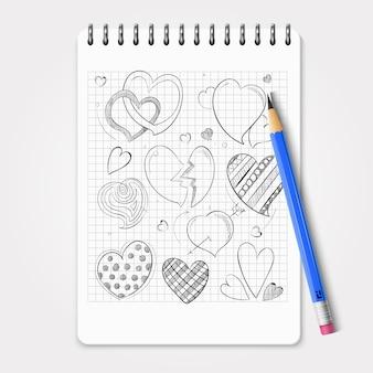 Conjunto de corações de mão desenhada com lápis realista e notebook