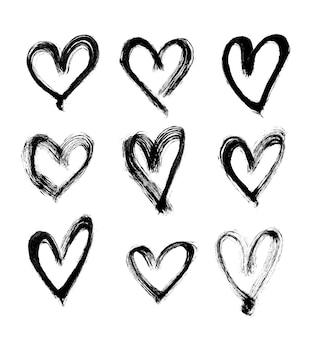 Conjunto de corações desenhados à mão. ilustração vetorial.