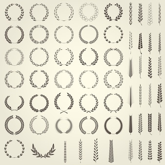 Conjunto de coroas de louros e espigas de trigo em estilo heráldico