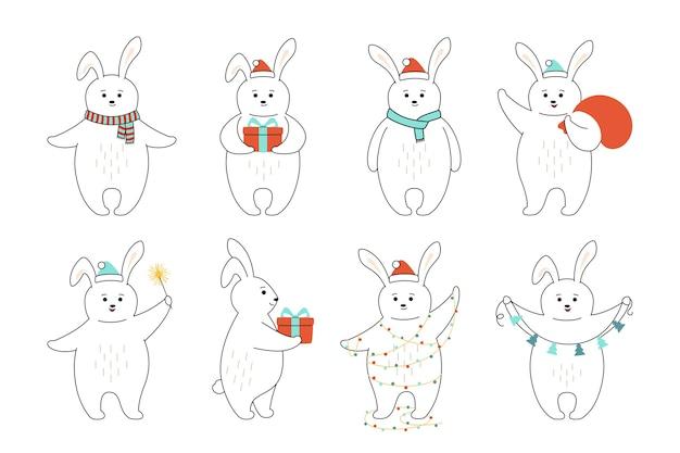Conjunto de desenhos animados de linha de coelho de natal.