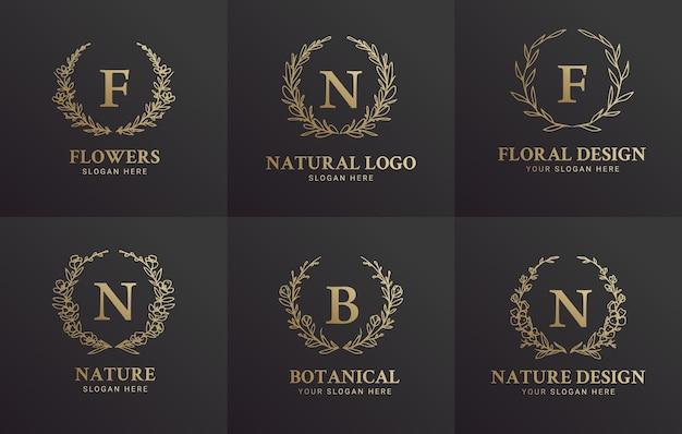 Conjunto de design de ilustração de logotipo botânico floral preto e dourado elegante desenhado à mão para beleza natural de marca orgânica