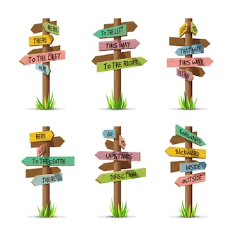 Conjunto de direção de placas de sinalização de seta de madeira colorida. sinal de madeira pós-conceito com grama. ilustração do ponteiro do tabuleiro com texto isolado em um fundo branco