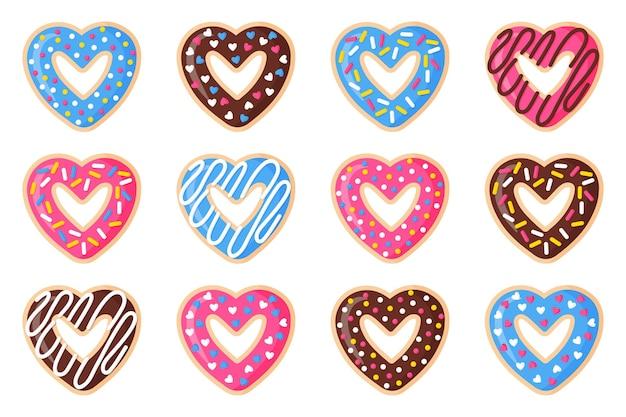 Conjunto de donuts em forma de coração com cobertura rosa, azul e chocolate.